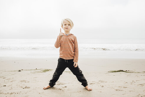 Portrait of young boy on beach, finger raised - CUF02112