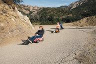 Three children, rolling downhill of toy cars - CUF02130