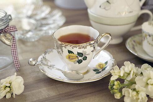 Quaint teacup and saucer on table - CUF02369