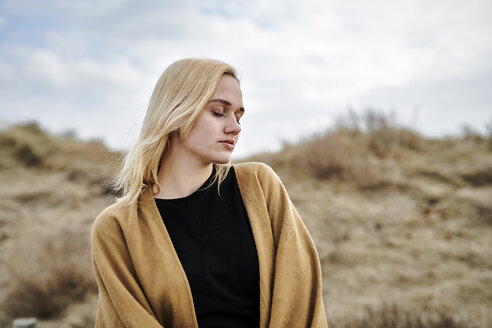 Portrait of blond young woman on the beach - MMIF00008