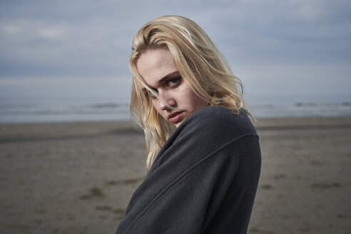 Portrait of blond young woman on the beach - MMIF00050