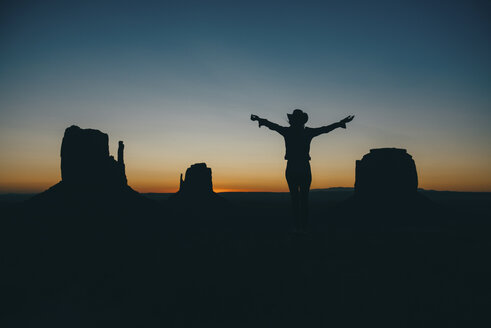 USA, Utah, Woman enjoying sunrise in Monument Valley - GEMF01950