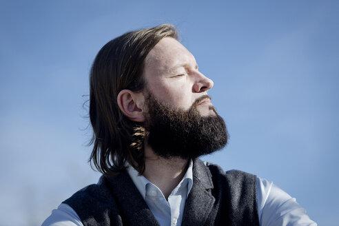 Portrait of bearded man enjoying sunlight - FLLF00036