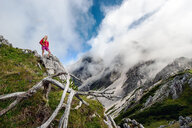 Austria, Salzburg State, Filzmoos, Female hiker looking at view - HHF05541