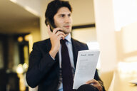 Businessman ordering room service in hotel - CUF02458