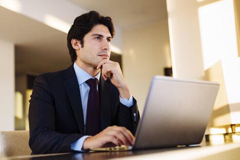 Businessman working in business centre in hotel - CUF02461