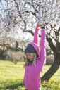 Young woman outdoors, exercising, stretching, arms raised - CUF02524