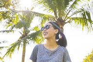 Young woman in park, Bangkok, Thailand - CUF02581