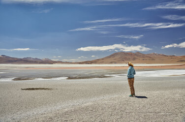 Woman standing, looking at view, Laguna Colorada, Colorada, Potosi, Bolivia, South America - CUF02629