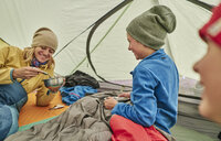 Mother and sons in tent, eating food from bowls, Ventilla, La Paz, Bolivia, South America - CUF02644