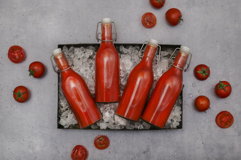 Ice-cooled homemade tomato juice in swing top bottles - RTBF01257