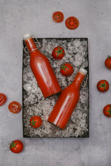 Ice-cooled homemade tomato juice in swing top bottles - RTBF01260