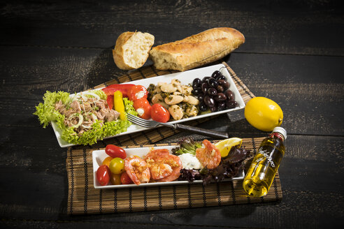 Antipasti, tuna, salad, filled paprika, white beans, black olive, shrimp, sour cream, tomato and white bread - MAEF12581