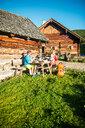 Family having a break fom hiking at alpine hut - HHF05558