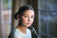 Young clarinettist posing with her clarinet - CUF02837