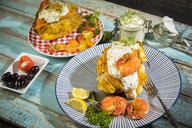 Baked Potato, sweet potato, Argentine red shrimp, sour cream on plate - MAEF12590
