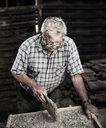Stonemason working on stone - CVF00454