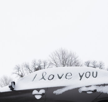I love you written in snow on car windows - CUF03410