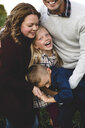 Family hugging and smiling - CUF03656