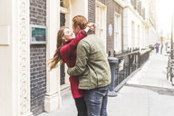 Couple hugging on street, London, UK - CUF03689