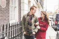 Couple chatting on street, London, UK - CUF03692