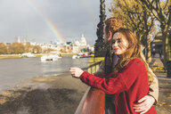 Couple enjoying view of the Thames, London, UK - CUF03698