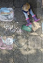 Little girl after drawing with chalk outdoors, top view - LHF00567