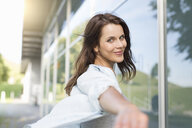 Portrait of happy businesswoman outside airport - CUF04014