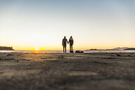 Couple watching sunset from Long Beach, Pacific Rim National Park, Vancouver Island, British Columbia, Canada - CUF04107