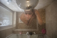 Overhead view of young woman in showering - ISF00961