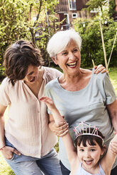 Portrait of senior woman with grown daughter and granddaughter, outdoors, laughing - ISF01117