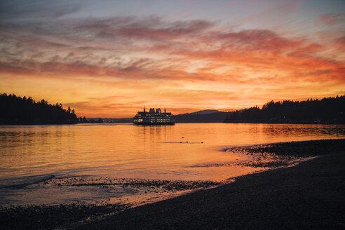 Ferry on Puget Sound at sunset, Bainbridge, Washington, United States - ISF01129