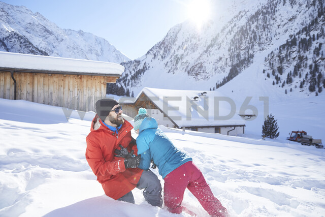 Active couple having fun in snow-covered landscape - CVF00486 - Christian Vorhofer/Westend61