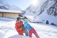 Active couple having fun in snow-covered landscape - CVF00486