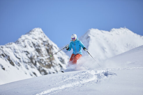Austria, Tyrol, Kuehtai, woman skiing in winter landscape - CVF00507