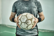 Close-up of indoor soccer player holding the ball - ZEDF01415