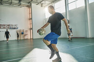 Indoor soccer player balancing the ball - ZEDF01424