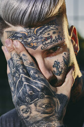 Close-up of tattooed face of young man - ZEDF01451
