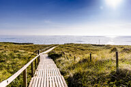 Germany, Schleswig-Holstein, Sylt, wooden walkway through dunes - EGBF00260