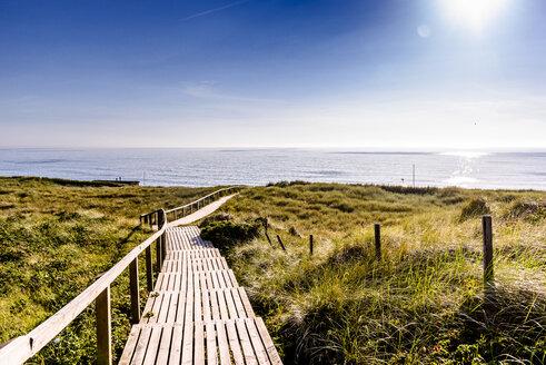 Germany, Schleswig-Holstein, Sylt, wooden walkway through dunes - EGBF00260
