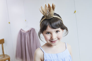 Portrait of young girl wearing crown headband, smiling - ISF01264