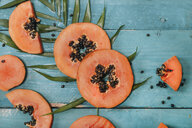 Sliced papaya on blue wood - RTBF01272