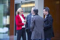 Businesspeople talking in street - CUF04903