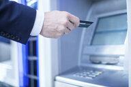 Man using cash machine - CUF04909