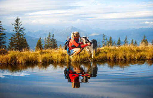 Austria, Salzburg State, female hiker with dog - HHF05567
