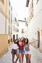 Spain, Mallorca, Palma, portrait of three happy young women in the city - IGGF00471