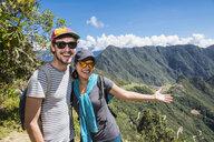 Couple posing for camera on the Inca Trail close to Machu Picchu, Cusco, Peru - CUF05959