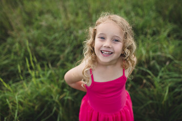 Portrait of blond haired girl in grass - CUF05974