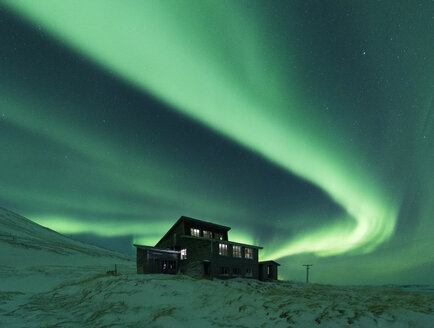 House under aurora borealis at night, Thingvellir, Iceland - CUF06184