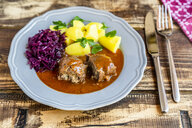 Beef roulade with potato and red cabbage on plate - SARF03754